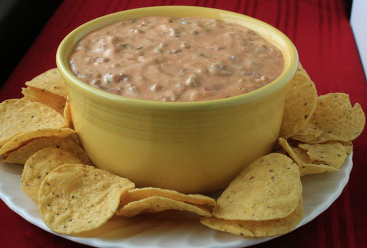 Jenny Adrian Hands via Lawanna Koehn 2 lb. hamburger 1/2 large onion, chopped 3 green onions, thinly sliced 1 lb. Velveeta cheese, cubed 1 can Cream of Mushroom soup 1 can Tomato soup 1/4 green pep…