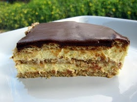 Chocolate Eclair Cake - Easy & delicious dessert made with graham crackers, French vanilla pudding mix, milk, Cool Whip, and a tub of chocolate icing.