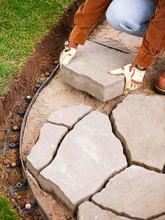 How to Install a Flagstone Paver Patio- A backyard patio can be so much more than a slab of concrete. Follow these step-by-step instructions to create an affordable outdoor oasis in your backyard using flagstone pavers.