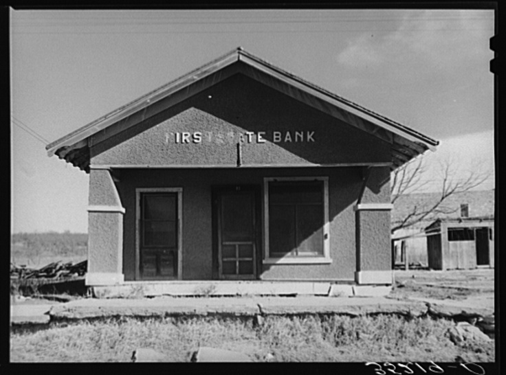 Deserted bank building in the oil ghost town of slick