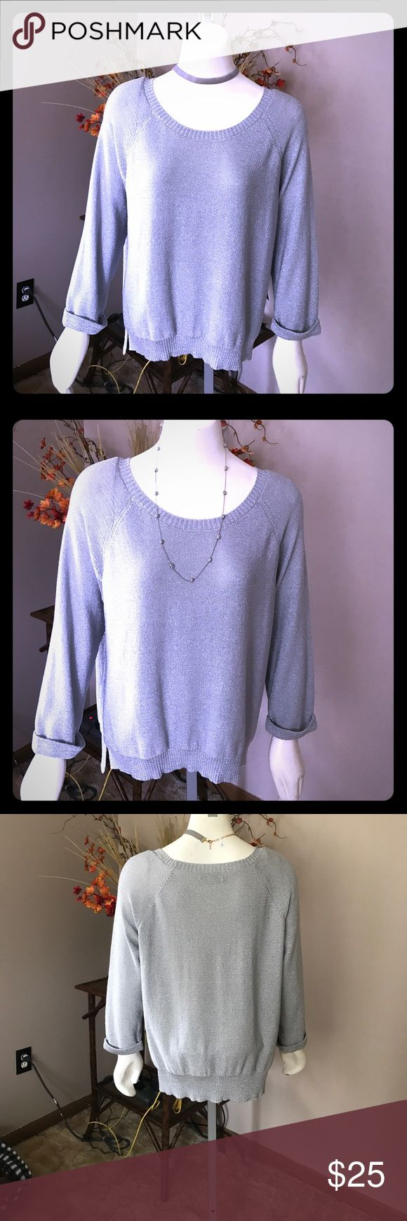 ❄️ J Lo silver sparkly sweater NWT size XL ❄️ ❄️ Get ready for the holidays with this silver sparkly sweater by Jennifer Lopez!! Absolutely beautiful !! Brand New with Tags. Size XL ❄️ Jennifer Lopez Sweaters Crew & Scoop Necks