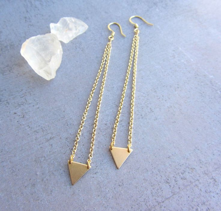 Minimalist dangle gold triangle long earrings, geometric jewelry, simple modern jewelry. $25.00, via Etsy.