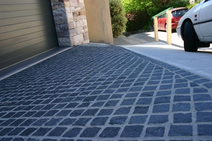 Charcoal Grey Granite Cobblestones - Supplied by Sareen Stone. www.sareenstone.com.au One of our most popular cobbles for driveways.
