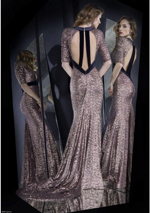 Get set to shine in this dazzling copper sequined dress. The slightly matte finish feels modern and fresh, and the black velvet details add a tough twist to this party dress. The sexy low back cut completes the dramatic red carpet look.