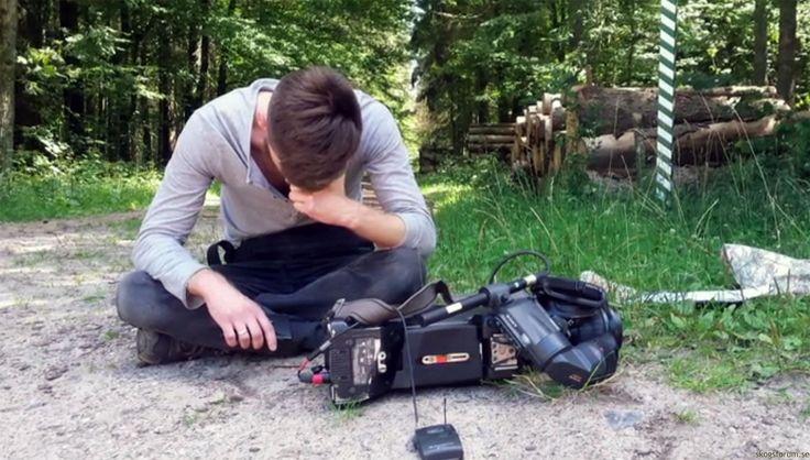 En kameraman skadades, en filmkamera skadades och minneskort plockades ur kameror när ett TV-team konfronterades med ett par skogshuggare...