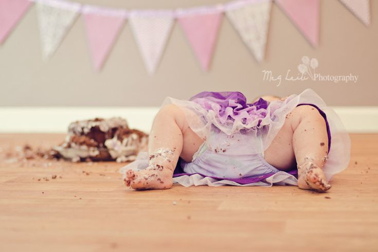 Smash Cake- My little Sophia after enjoying way too much of her smash cake lol! She couldn't even sit up on her own after this :)