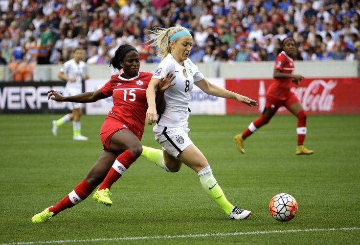 United States' Julie Johnston (8) keeps Canada's Nichelle Prince (15) from the ball during the first half of the CONCACAF Olympic women's soccer qualifying championship final Sunday, Feb. 21, 2016, in Houston