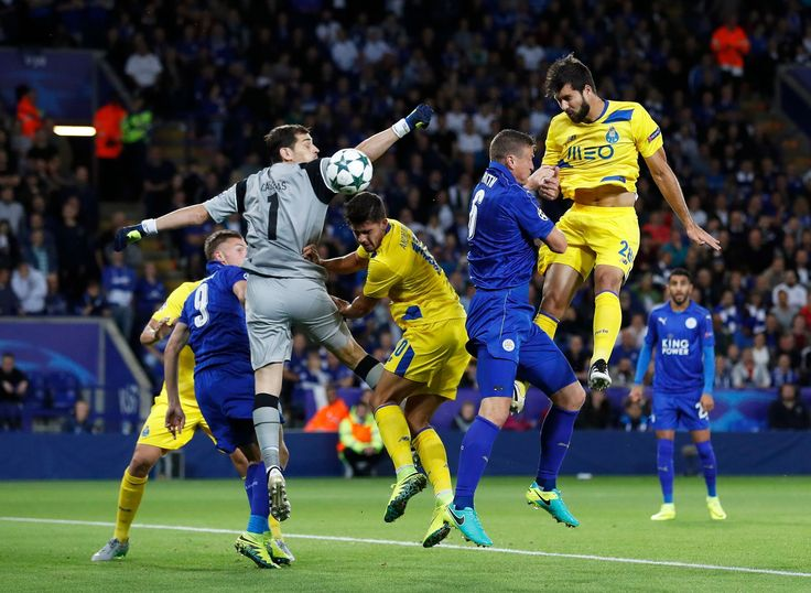 FC Porto's Iker Casillas and Felipe in action with Leicester City's Robert Huth