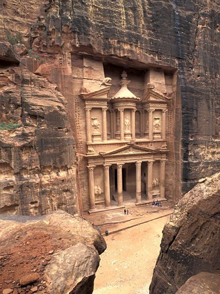"""Petra, hidden in a deep gorge in Jordan, was once described as """"the rose red city half as old as time."""" Yet it is still young compared to neighboring Iron Age settlements. Whereas the façade of its famous Treasury was carved some two thousand years ago, archaeologist Thomas E. Levy has been working in the nearby Wadi Faynan, which was a center of copper mining, on a practically industrial scale, a thousand years earlier still."""