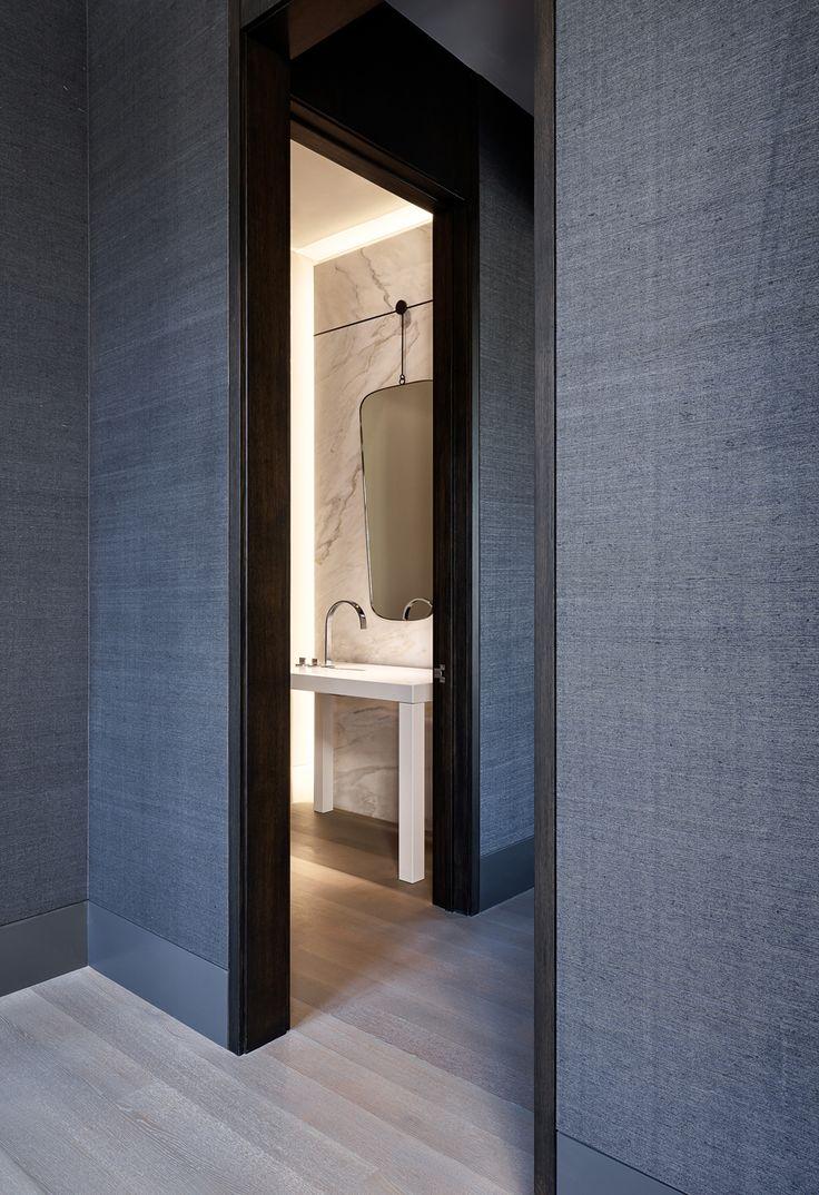 Grasscloth and black trimwork // Bathroom by Design Mastermind Matthew Leverone