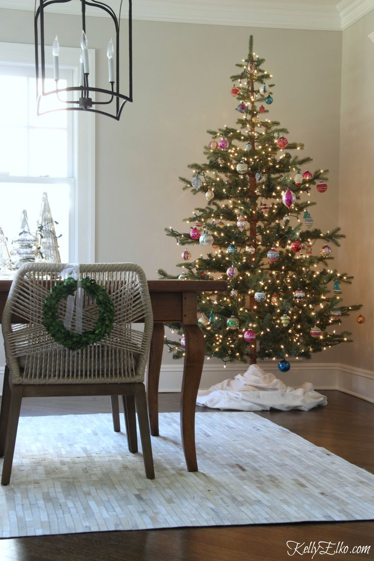 Love this sparse Christmas tree that's perfect for displaying vintage Shiny Brite ornaments and the tablecloth from HomeGoods used as a tree skirt kellyelko.com sponsored pin #christmas #ChristmasTree
