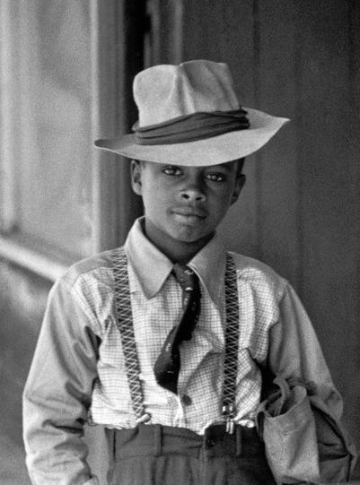 Photograph of a dapper young boy by Henri Cartier-Bresson.