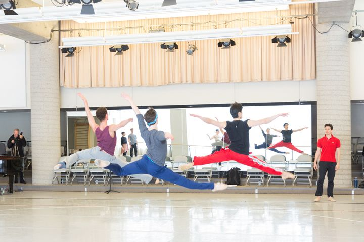 Aritsts of the Ballet soar during rehearsal for Le Petit Prince with Guillaume Côté. Photo by Aleksandar Antonijevic.