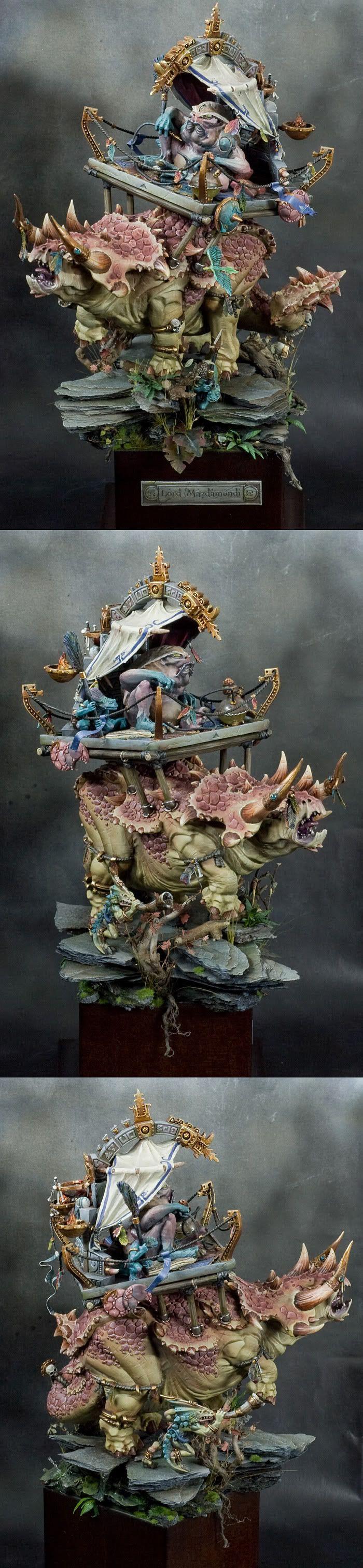 golden demon winner, Mazdamundi!!!!!!!!!!!!!!!! he just rides a stegadon 'couse he's friggin awsome