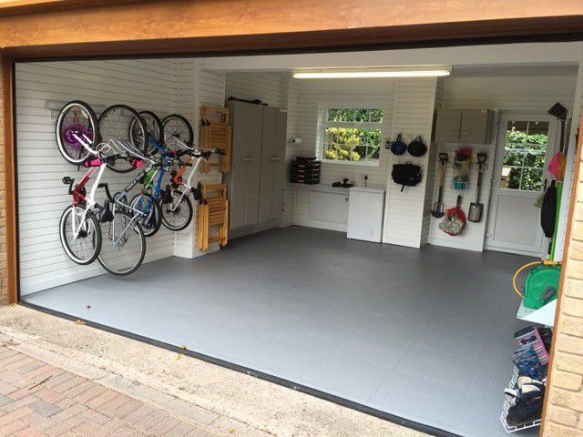 Light grey floor tiles work very well in this garage and contributes to a lovely light feel