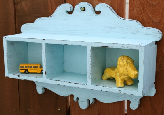 """Shabby Chic Vintage Blue Wood Shelf $65 Pretty vintage-inspired blue wood shelf with handy little cubbies to hold, display keepsakes, or organize collections. Hand-made, hand-painted and gently distressed to give it sweet shabby charm, this shelf will make a graceful addition to your cozy home. Finished with a clear matte acrylic varnish for protection and lasting beauty.    Dimensions: 18"""" long x 12.75"""" high x 4.375"""" deep. Cubbies measure 4"""" high x 5"""" wide x 4"""" deep. Weighs 4 lbs. 5 oz…"""