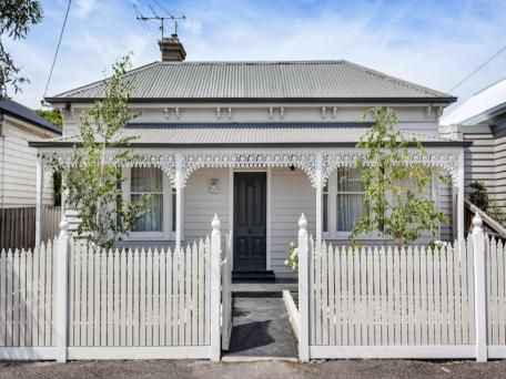 Pale stone and white Victorian house with black door. 45 Alexander Street Seddon Vic 3011