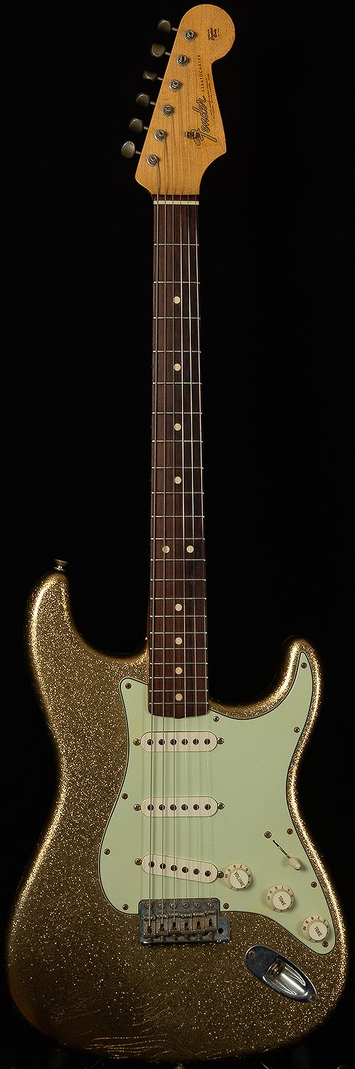 Fender Custom Shop Stratocaster in gold sparkle. I like sparkly things.