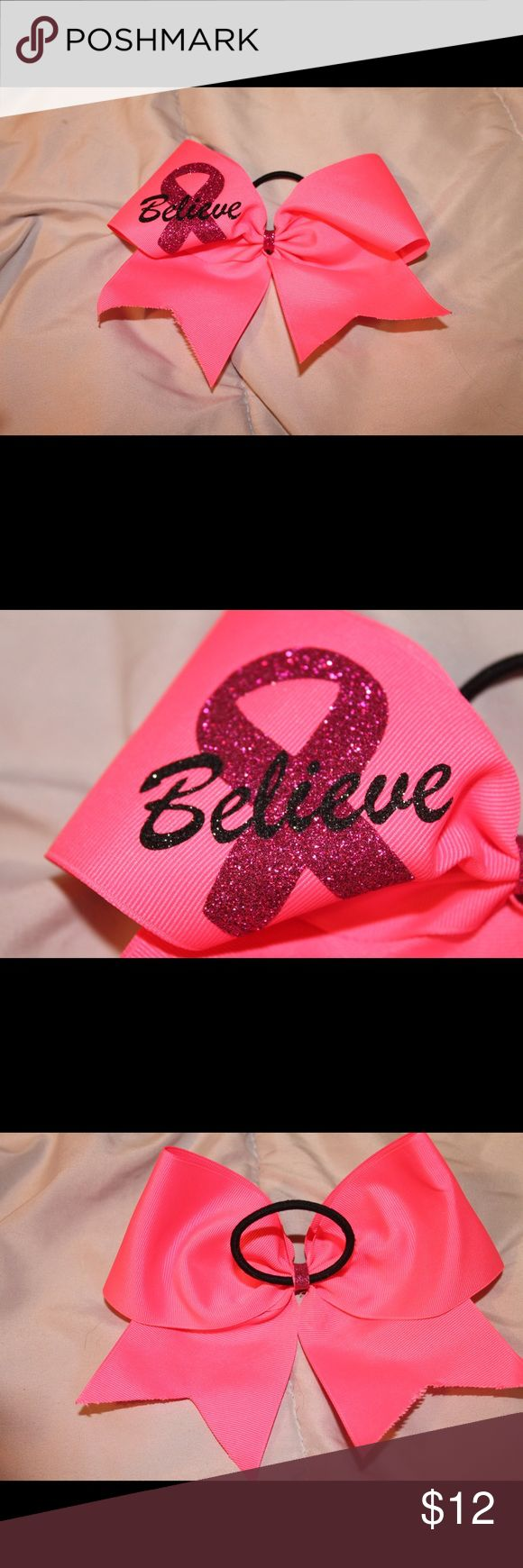 Breast Cancer Awareness Cheer Bow! Hot pink cheer bow for breast cancer awareness month. Sparkly pink ribbon on the left side with the words believe. Bow attached to a pony tail. Only worn once for about two hours! Make an offer:) Other