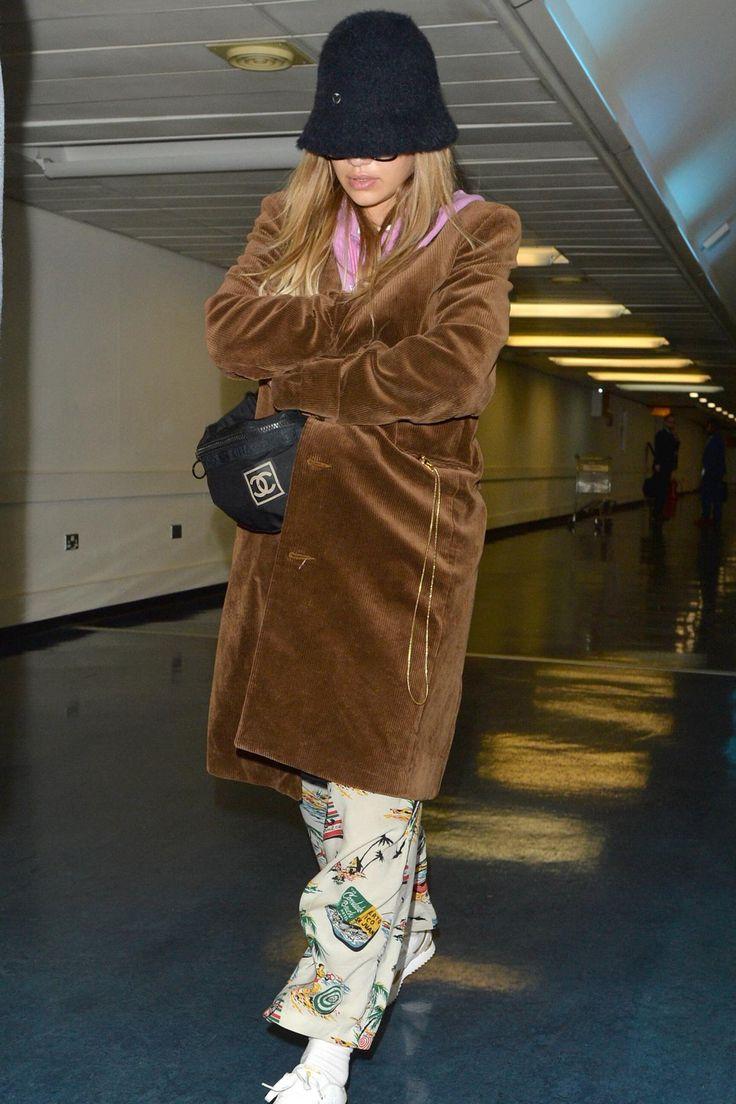 Rita Ora wearing Charlotte Simone Bella Bucket Hat, Reebok Royal Sneakers and Chanel Sports Line Waist Bag