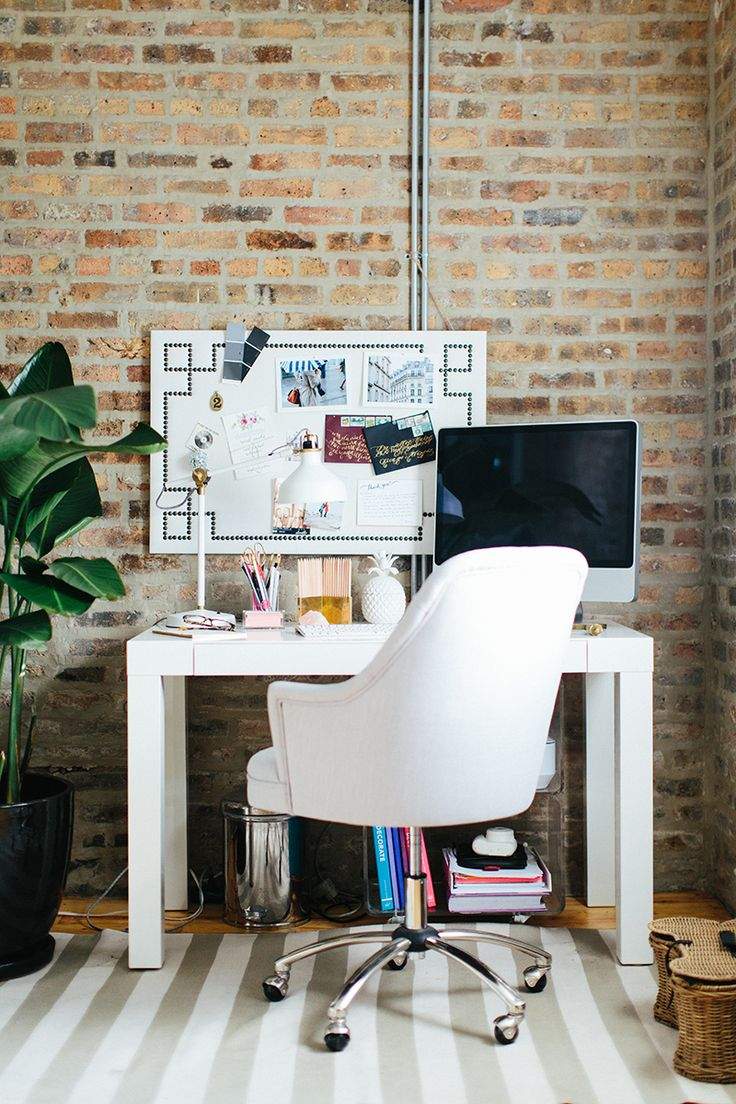 Very pretty home office as seen at The Everygirl Cofounders' Chicago Home and Office Tour. White table and white leather chair, stripped carpet, white board