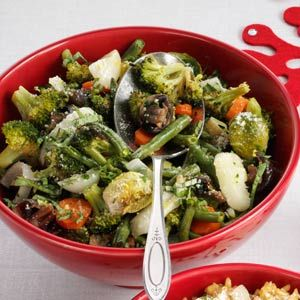 Roasted Green Vegetable Medley Recipe from Taste of Home | Roasting vegetables like broccoli, green beans and Brussels sprouts is a great way to serve them, and almost any veggie combo works.
