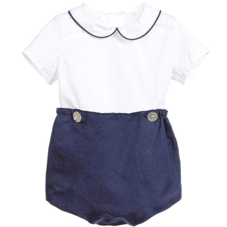 A smart, traditional piece, this boys buster suit from Ancar combines a white cotton top with navy blue linen attached shorts with elasticated cuffs. A rounded collar and mother of pearl buttons finish the look perfectly.<br /> <br /> Model: Weight 5.8kg /12.8Ib (average 6 months)<br /> Size of suit shown in the photo: 6 months <ul> <li>Top: cotton</li> <li>Shorts: cotton/linen mix</li> <li>Machine wash (30*C)</li> <li>Small fitting</li> </ul>