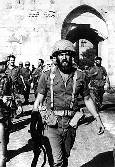 "Shimon ""Katcha"" Cahaner leads Israeli troops thorough the Lion's Gate into Jerusalem in 1967 after defeating Jordanian troops on Ammunition Hill."