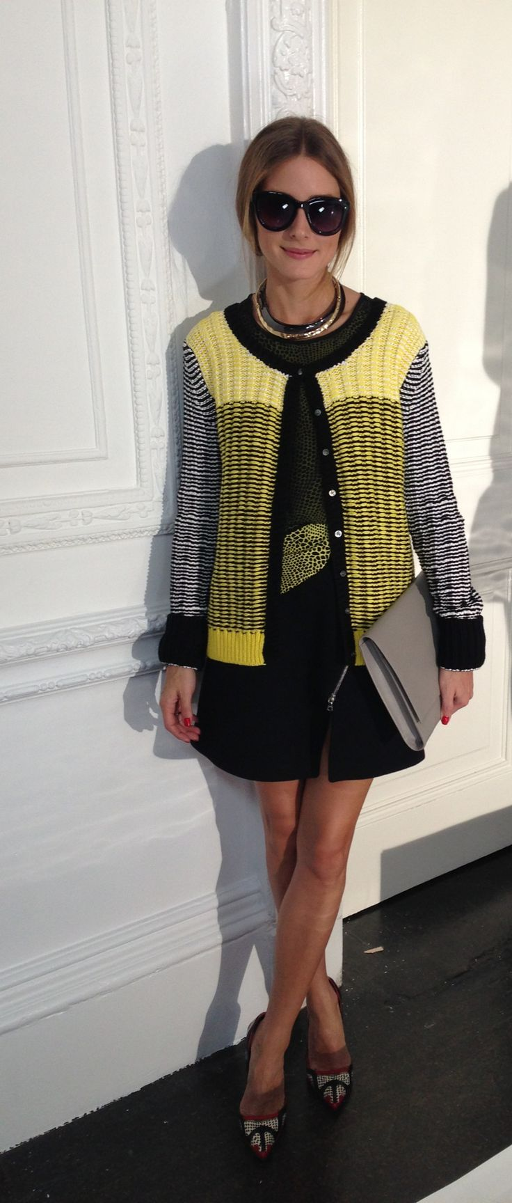 Olivia Palermo at LFW 2013 Markus Lupfer's presentation wearing a Markus Lupfer Skirt and Sweater and top by Tibi.  Accessories: sunglasses are Witchery and clutch is by Smythson.