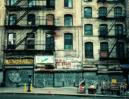 Urban decay and graffiti on Canal Street, Chinatown, NYC. Photo by Vivienne Gucwa.