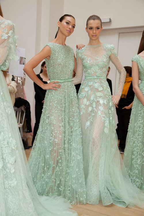 The way these Ellie Saab dresses fall is lovely, and the mint green leaves are splendid. I expect the shape of mine will be similar.