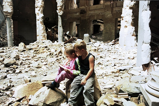 THE SIEGE OF SARAJEVO    Two young boys read a page from a book in the recently destroyed  National and University Library of Bosnia in Sarajevo, Bosnia, on  Monday, September 7, 1992..