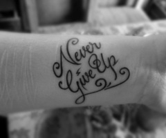 Love this tattoo. Look at the scars... I have always wanted a tattoo on my wrist, a survivor of slef injury
