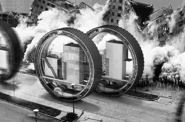 """The """"Migrant Skyscraper"""": The building-inside-a-wheel can stay stationary for however long residents please, but, for example, if political upheaval destabilizes a region, residents can fire up the biofuel-powered engine and cruise to a new location. Inside 2buildings +surrounding green space provide everything residents need to survive.     Designers: Damian Przybyła by Rafał Przybyła"""
