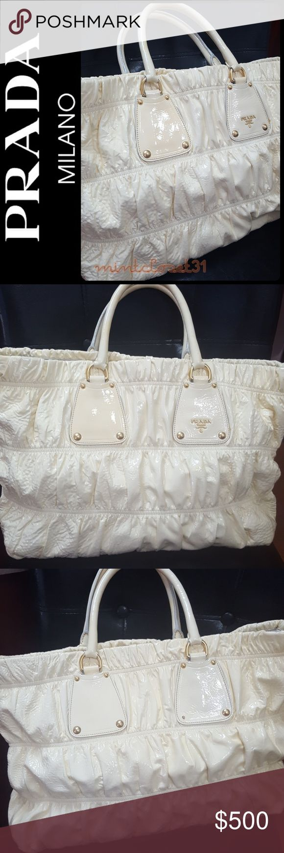 Prada Italy Patent Leather Tote Bag Prada Designer Handbag in Gorgeous Patent Leather Tote with Faint Yellow Shade! Features the Iconic Prada logo Emblem Adornment on Front! Crafted from Prada Signature Luxurious Gaufre Collection! Gold Tone Hardware with