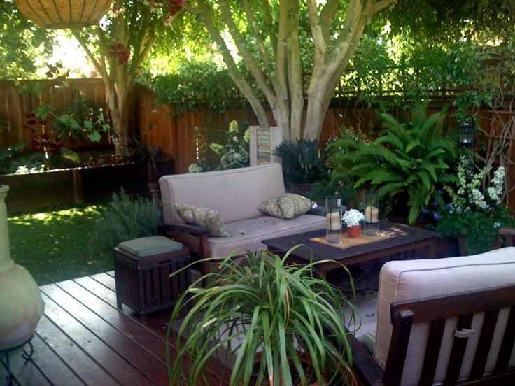 I\'ve included the before picture as well.  We removed the flagstone, built wood patio/deck, installed artificial grass, stained the fence, added water feature, furniture and plants.  Nice and secluded small back yard / patio in southern california town home complex of 222 units.