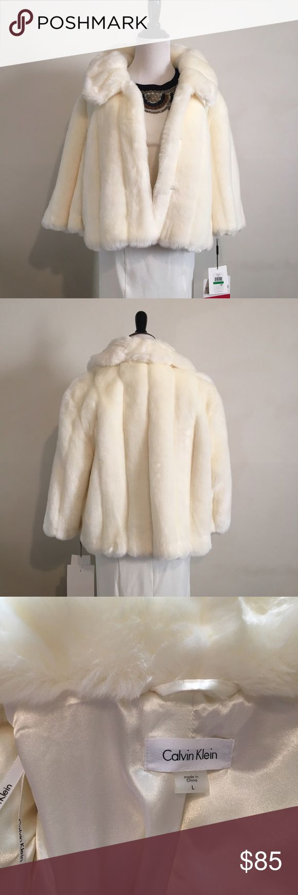 Calvin Klein Faux fur Bolero Extra lush faux fur in ivory lined with satin made by Calvin Klein. Extra buttons and tags attached. Don't miss this super soft and luxurious shawl perfect for dressing up outfits. Jackets & Coats Capes