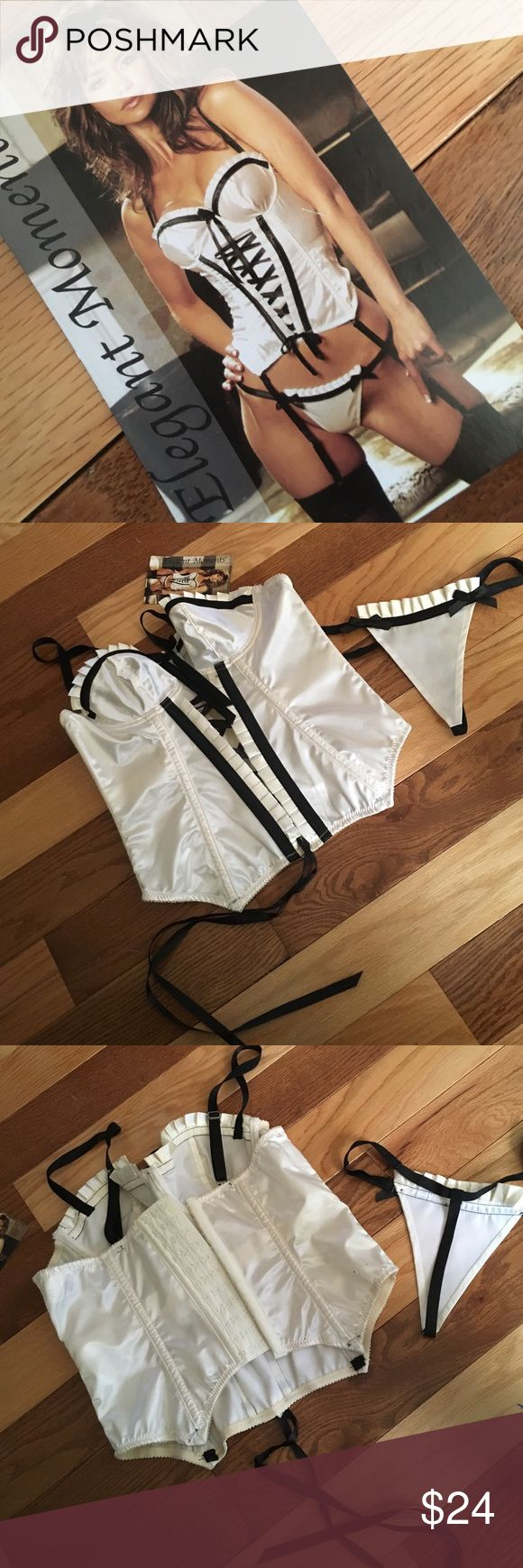 Cream and Black Corset w bottoms Corset has three rows of hooks at the back and the front has adjustable ribbon. Bottoms are as pictured. Garter straps included.           Sz 32 (S)chest 28-30.                                          Sz 36 (L)chest 34-36.                                          Sz 38 (XL)chest 36-38.     Bundle to save. Elegant Moments Intimates & Sleepwear