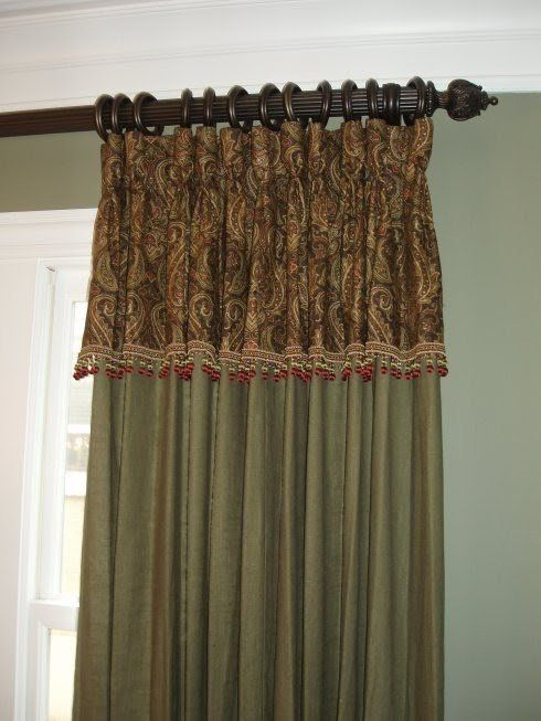 Stylish curtain made of fabric and finished with decorative