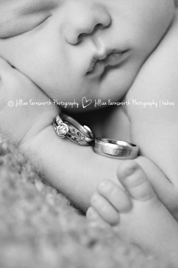I was looking for a new way of incorporating wedding rings into a newborn photography session. I'm very pleased with how this shot turned out.