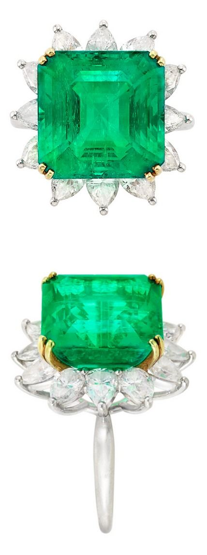 Platinum, Gold, Emerald and Diamond Ring, Tiffany & Co. Centering one cut-cornered square-shaped emerald-cut emerald approximately 9.50 cts., surrounded by 12 pear-shaped diamonds approximately 3.75 cts., signed Tiffany & Co