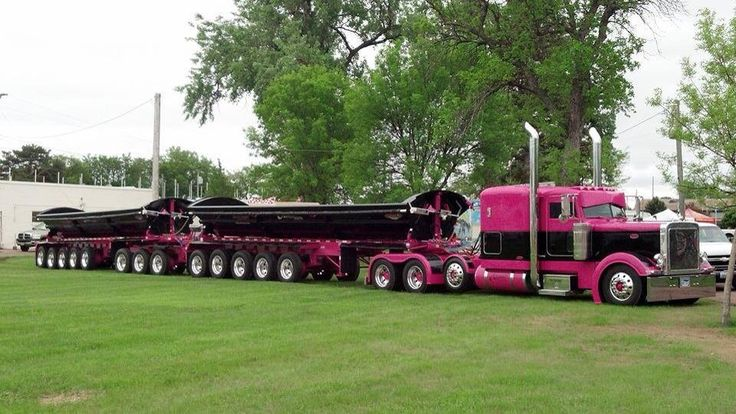 Pink and black Peterbilt heavy haul side dumper.  What an awesome truck and trailers