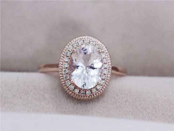 I love this! One of my new favorites. VS 7x9mm Oval Morganite Ring 0.13ct Diamond by AbbyandWills