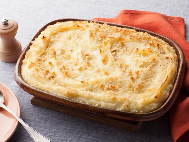 Baked Mashed Potatoes with Parmesan Cheese and Bread Crumbs by @Giada De Laurentiis. Delicious!