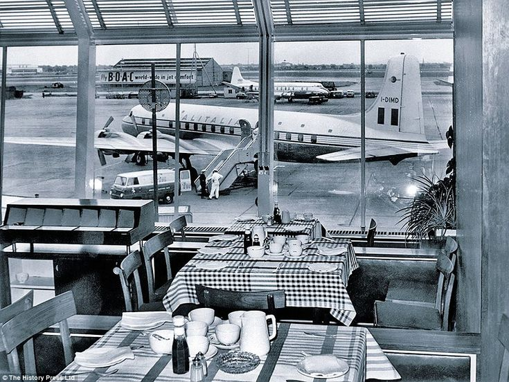 Runway view: This terminal building restaurant in 1958 overlooks the tarmac as staff prepare an Alitalia Douglas DC-6B I-DIMB