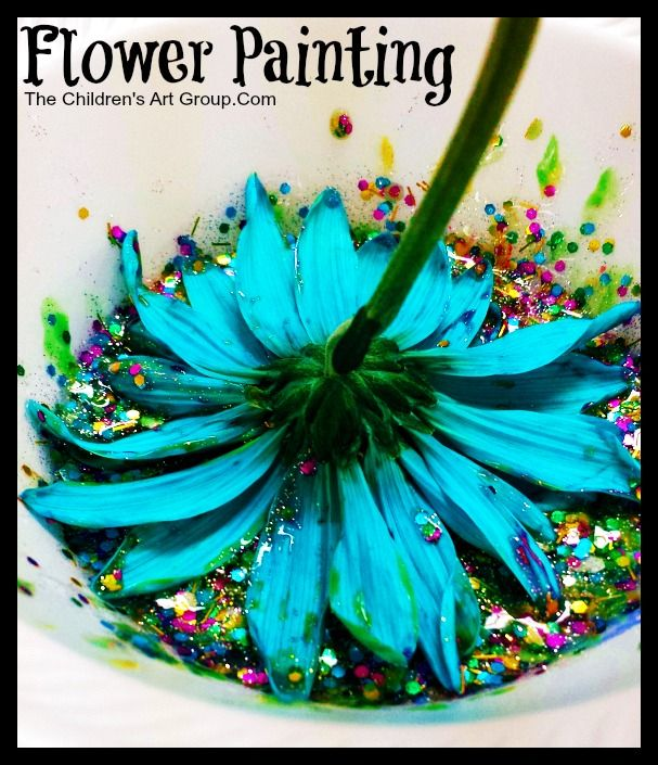 Flower Painting…  It is a simple setup with just paint and flowers. The kids can actually paint the flowers, paint with the flowers, or both!