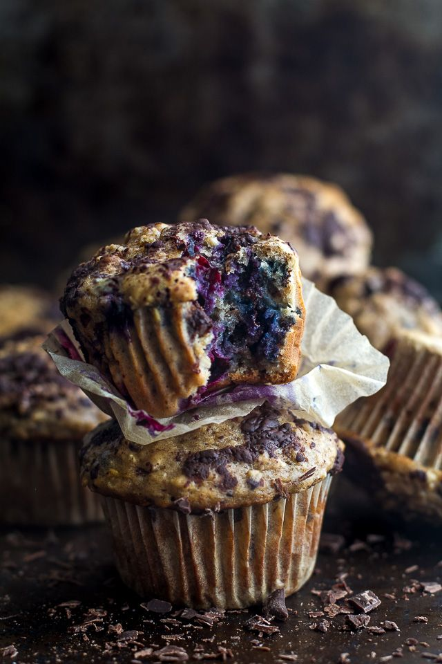 These ridiculously soft and tender dark chocolate blueberry banana oat muffins are made with NO butter or oil, and LOADED with blueberries and chocolate.