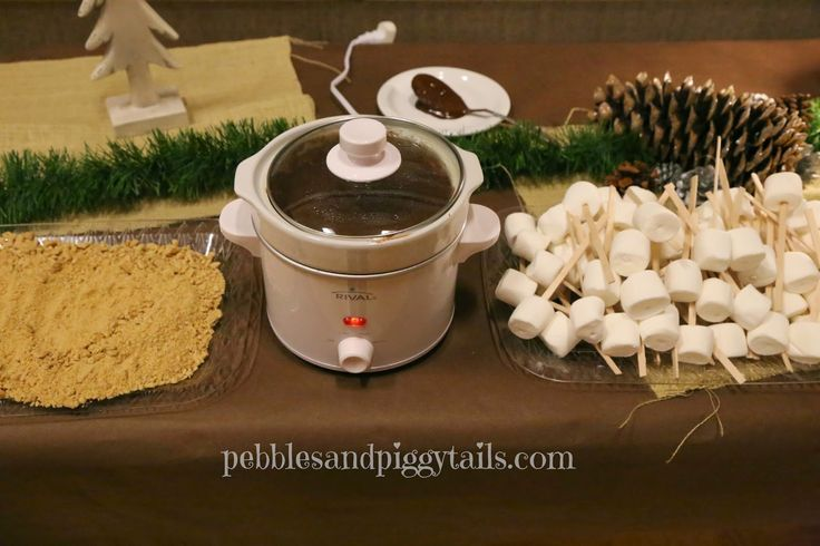 National S'mores Day crock pot s'mores on a stick. Indoor Camping Ideas