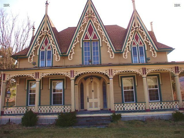 gothic revival house | Gothic Revival house -- tan siding, with cream, red and green trim ...