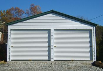 "Steel Garage Kits DIY Sample 20' wide x 20' long x 8' leg height x 11' 8"" peak height Sample Shows Additional Options: 2 – 9' wide x 7' high roll-up steel garage doors in the end wall Vertical style roof 1 - 32"" x 72"" walk-thru door Colors: Top – Evergreen, Sides – White, Trim White View more here:  http://www.gaport.com/steel/garages-kits-diy.htm"